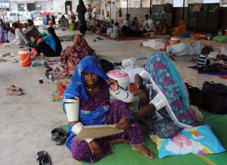 In this June 25, 2015 file photo, people sit outside a local hospital where hundreds of people are admitted suffering from heatstroke and dehydration due to sever weather in Hyderabad, Pakistan. Earth's wild weather this year is bursting the annual heat record, the World Meteorological Organization announced Wednesday, Nov. 25. (AP Photo/Pevaiz Masih, File)