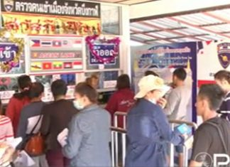 Thai - Lao border crossing bustles with activities