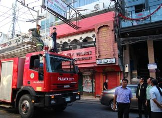 City officials, led by City Councilman Anupong Bhudanawarut, bring a fire engine along to check signage heights on Walking Street.