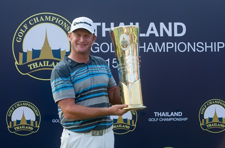 Jamie Donaldson of Wales holds up the trophy after winning the 2015 Thailand Golf Championship at Amata Spring Country Club in Chonburi, Sunday, December 13.