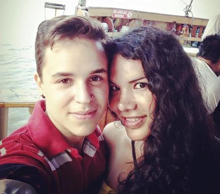 This Nov. 11, 2015 photo courtesy of Fernando Machado shows him, left, taking a selfie with his partner Diane Rodriguez in Guayaquil, Ecuador. (Fernando Machado via AP)