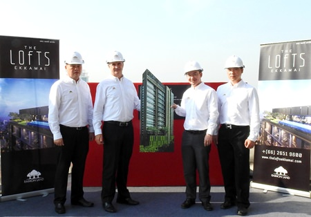 (From left to right) Raimon Land executives Clifford Chan, Manager – Project Commercial; Gerard Healy, Vice President – Development; Sataporn Amornvorapak, Director & Chief Financial Officer; and Chaipat Taechapornwiwat, Deputy Vice President – Construction, pose for a photo during the topping-off ceremony for The Lofts Ekkamai in Bangkok on February 5.
