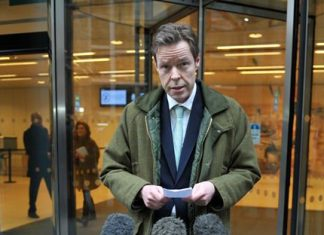 George Bingham, the only son of missing peer Lord Lucan, speaks to the media outside the High Court in London. (Nick Ansell/PA via AP)