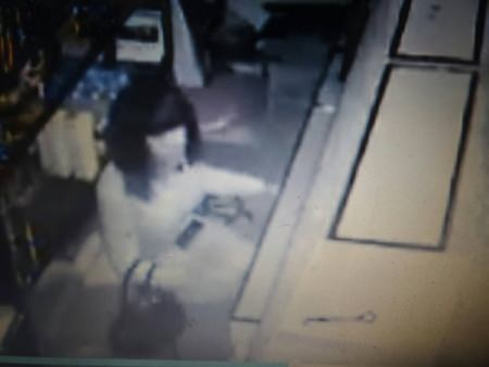 Video footage from a security camera shows a transgender guest breaking into the cash drawer at 3:45 a.m.