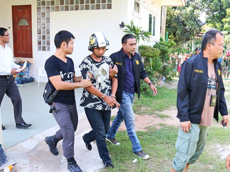 Police take away Tatpong Thamnai to face charges of burglary, murder and necrophilia.
