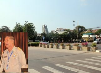 Pattaya city councilman, Sanit Boonmachai (inset) is lobbying to fully reopen the traffic circle at the Dolphin Roundabout, or install a fully functional traffic light to improve traffic there.
