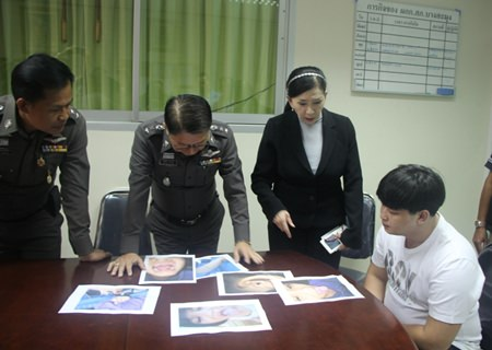 Human Security Minister Paveena Hongsakula (2nd right) was able to inspire police to arrest Saran Khampakdee (seated), son of a senior police officer, for physical abuse of his 7-year-old stepdaughter.