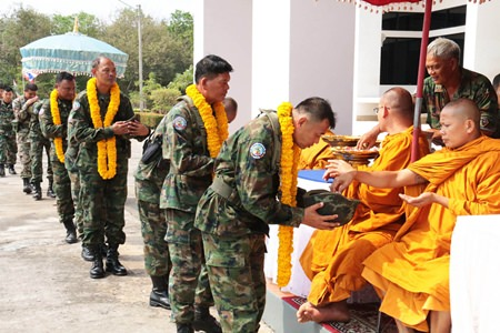 Buddhist monks bless the soldiers before they embark on their mission.