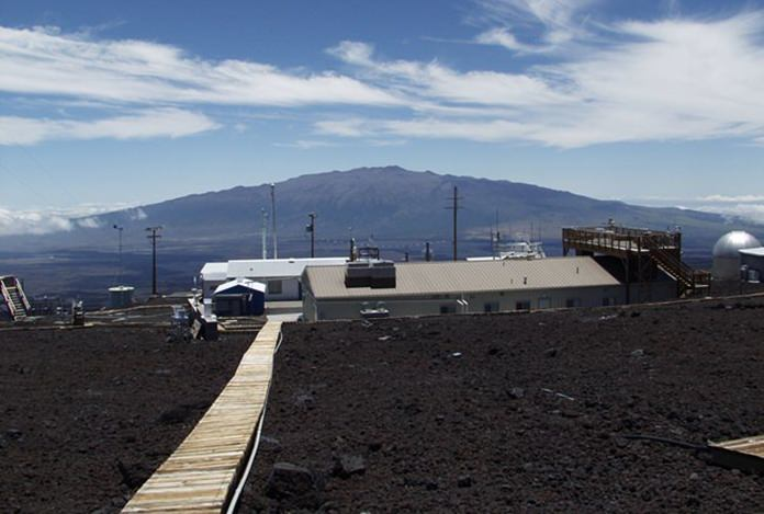 This photo provided NOAA, shows NOAA's Mauna Loa Observatory in Hawaii. Measurements show the amount of heat-trapping carbon dioxide in the air jumped by the biggest amount on record last month, a rise amplified by El Nino, scientists say. (NOAA via AP)