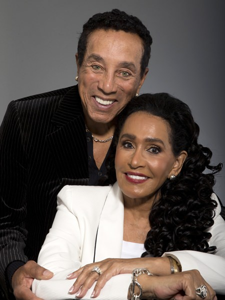 In this May 27, 2016 photo, music legend Smokey Robinson and his wife, Frances Gladney, pose in Los Angeles to promote their new skincare lines. (AP Photo/Jae C. Hong)