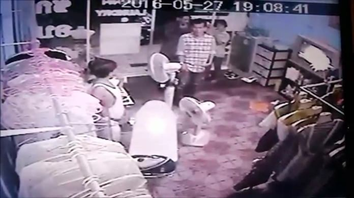 An East Pattaya laundry owner, upset with police action, took security camera photos of alleged extortion by police impersonators to the public.