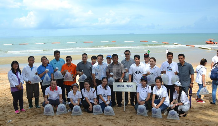 Staff of the Dusit Thani Pattaya Hotel pose for a group photo before releasing their fish.