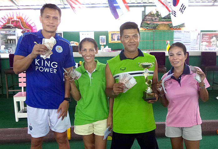 Buzz (2nd right) holds the trophy as he poses for a photo with runner-up Nit (right) and beaten semi finalists Yong and Sue.