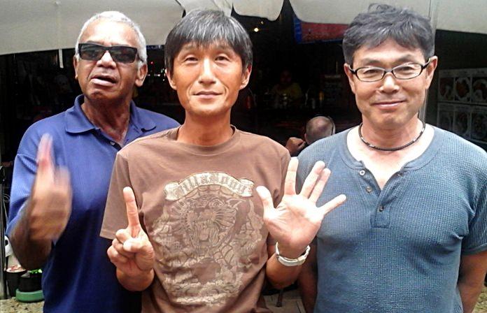 Fred Graham, medal winner Kenny Aihara and Yasuo Sakai.