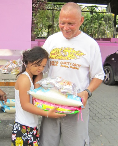 Bill distributing rice and noodles to disabled girl.