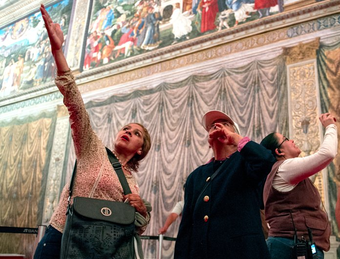 Visitors look at a replica of the Sistine Chapel in Mexico City, Thursday, June 9, 2016. (AP Photo/Nick Wagner)