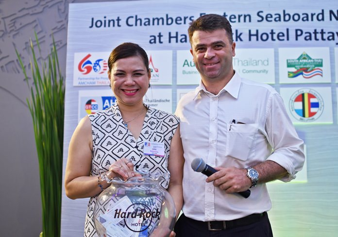 (L to R) Sarudha Netsawang, membership services director at AmCham Thailand, and Vincent Pourre, corporate account manager at Wall Street English Thailand.