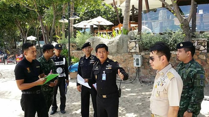 Pol. Lt. Jeerawat Sukontasap (center), head of Pattaya's Municipal Police, leads an inspection team to Pratamnak and Wong Amat beaches.