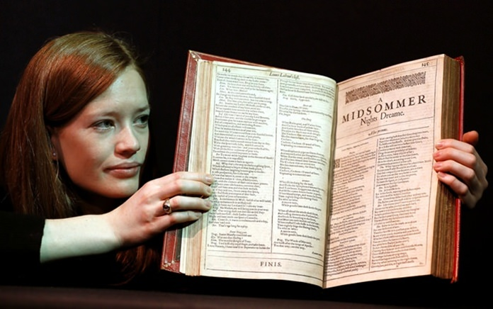 A Christie's member of staff displays an unrecorded copy of the First Folio, the first collected edition of Shakespeare's plays, widely considered the most important literary publication in the English language. (AP Photo/Kirsty Wigglesworth)