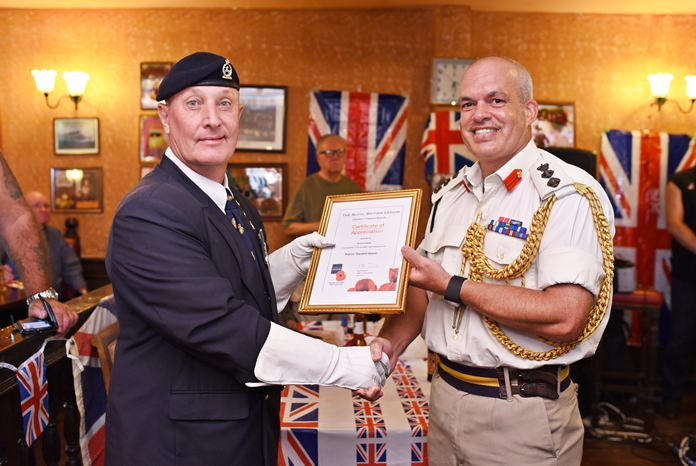 RBL Standard Bearer Richard Holmes receives a certificate of appreciation from Colonel Chris Luckham, Assistant Defence Attaché.