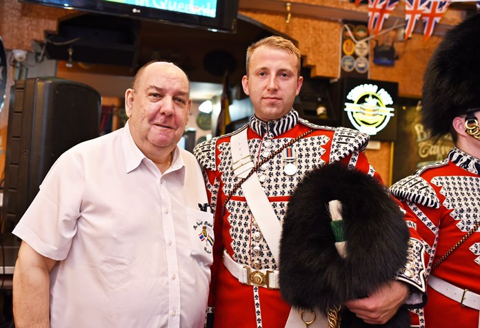 Secretary and Welfare Chairman of the Royal British Legion Thailand Bert Elson with one of the Welsh Guards.