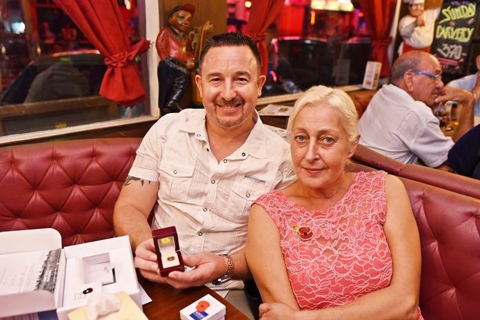 The limited edition Somme 100 poppy pin was purchased during the auction by Martin Coxan, pictured here with Caroline Worthington.