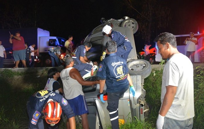 Rescue workers extricate passengers from the crashed van.