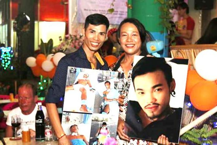 Party-participants show pictures of Vichet before and after the accident.
