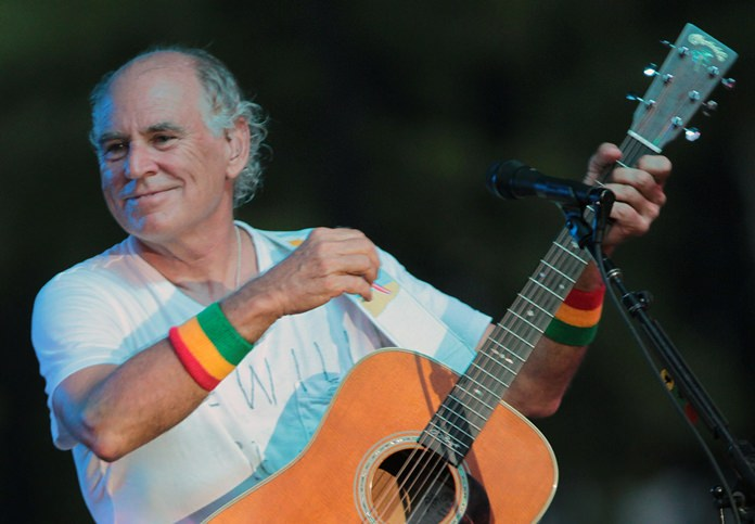 "In this June 30, 2010, file photo, Jimmy Buffett performs at his sister's restaurant in Gulf Shores, Ala. The Jimmy Buffett musical making its world premiere in 2017 in California has a new name and a Tony Award-winning creative support team. The musical is now titled ""Escape to Margaritaville."" (AP Photo/Dave Martin)"