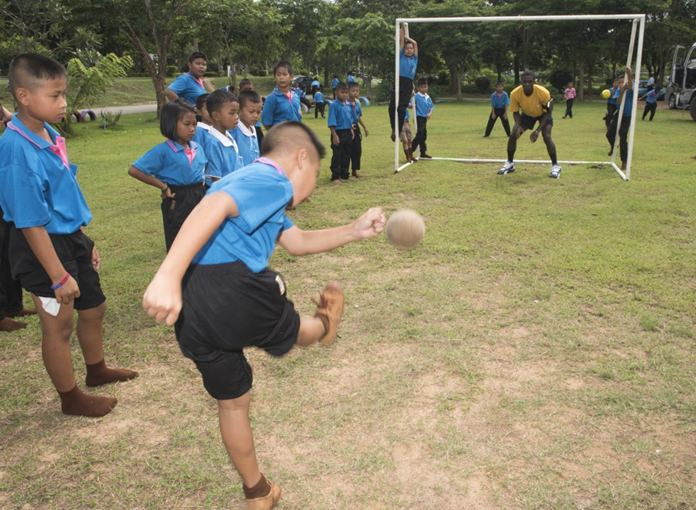 Sattahip (June 22, 2016) Operations Specialist 1st Class Charlon Clarke plays soccer with children from Chuksamet School during a community service event in support of CARAT Thailand 2016. (U.S. Navy photo by Mass Communication Specialist 2nd Class Joshua Fulton/Released)