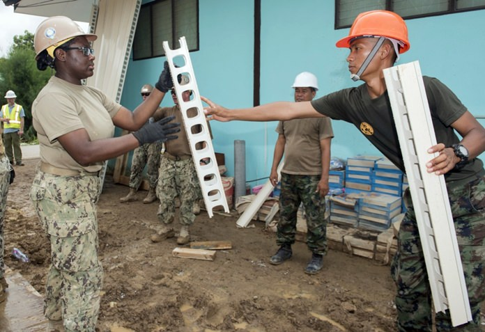 Sattahip (June 21, 2016) Construction builder Kiara Harris from Naval Mobile Construction Battalion (NMCB) 4 works with a Royal Thai Navy Seabee to construct a library at Khao Chi Chan School CARAT 2016. (U.S. Navy photo by Mass Communication Specialist 2nd Class Joshua Fulton/Released)