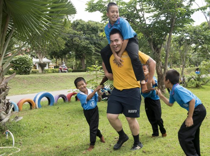 Sattahip (June 22, 2016) Culinary Specialist Seaman Andre Galit plays with children from Chuksamet School during a community service event. (U.S. Navy photo by Mass Communication Specialist 2nd Class Joshua Fulton/Released)