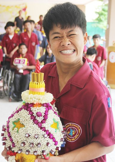 On Wai Khru Day, students present floral decorations to their teachers.