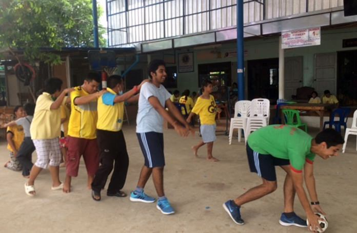 IB students from GIS lead the way in a ball game.
