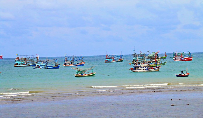 Many fishing boats were forced ashore as storms whipped up the waters off Sattahip Bay.