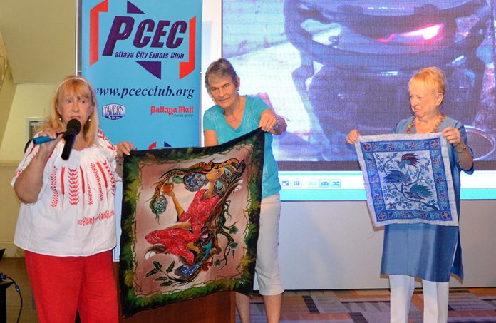 Gillian and Anne show some of the batik cloths they purchased in Solo. Gillian points out that the ones shown are quality batik as the picture is on both sides whereas the lesser pieces will be blank on the reverse.