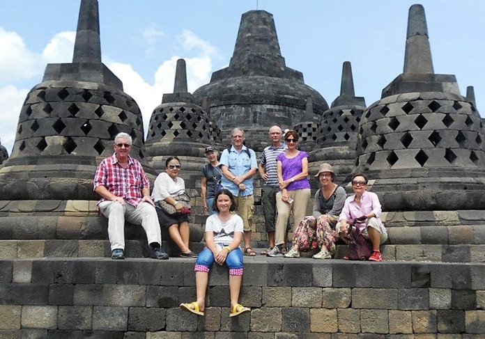 "Nine members of the group pose for a picture after reaching the upper three levels at Bourabudur; ""the abode of the gods."""