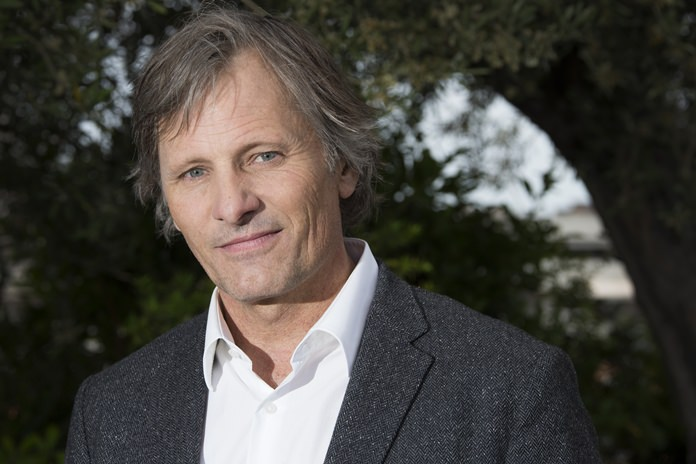 """In this May 18, 2016 file photo, actor Viggo Mortensen poses for photographs for the film """"Captain Fantastic"""" at the 69th international film festival, Cannes, southern France. (AP Photo/Joel Ryan)"""
