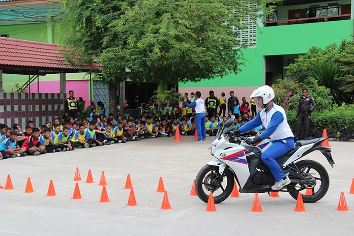 A member of staff demonstrates how to drive through cone obstacles.