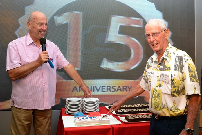 Roy Albiston calls on Richard Smith for the honor of cutting the first slice from the PCEC's 15th Anniversary cake; Richard has been a member since the early beginning of the PCEC and remained a mainstay in keeping the club going for more than 15 years.