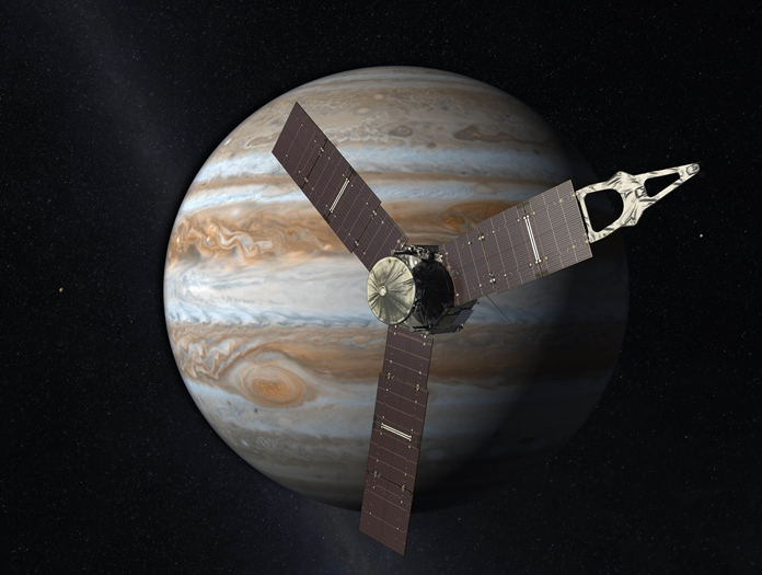 This artist's rendering provided by NASA and JPL-Caltech shows the Juno spacecraft above the planet Jupiter. Five years after its launch from Earth, Juno entered into orbit around the gas giant on Monday, July 4, 2016. (NASA/JPL-Caltech via AP)