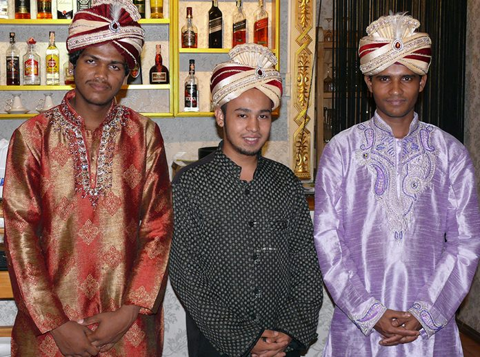 Indian waiters dressed in Indian style.