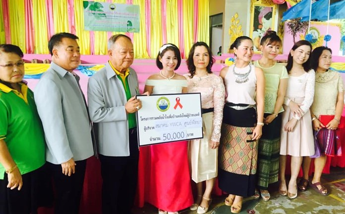 The YWCA Bangkok-Pattaya Center donated 50,000 baht July 12 to an embattled AIDS hospice to help it relocate to a friendlier community. (Photo courtesy YWCA Bangkok-Pattaya)