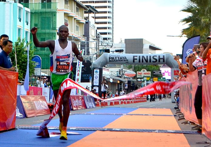 Kenya's Noah Chepsergon crosses the finish line to win the 2016 Pattaya Marathon, Sunday, July 17.