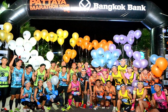 Runners pose at the start line prior to the 2016 Pattaya marathon race.