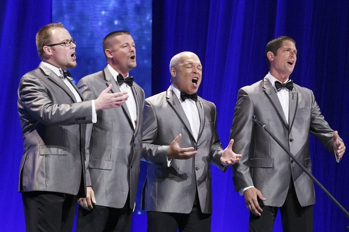 Members of the barbershop quartet Forefront compete at the Bridgestone Arena in Nashville, Tenn., July 9, 2016. The group took home the Barbershop World Quartet gold medal. (Lorin May/Barbershop Harmony Society via AP)