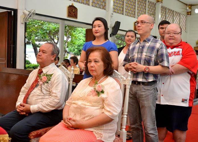 The grown-up children join in the joyful ceremonies.
