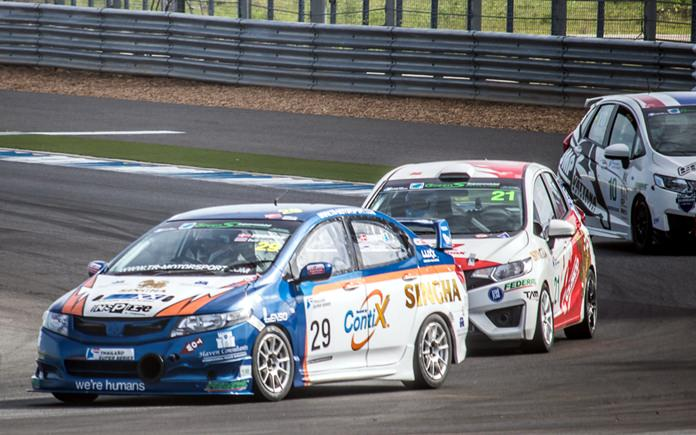 Raldorf (left) steers his Honda City through a corner during Race 1.