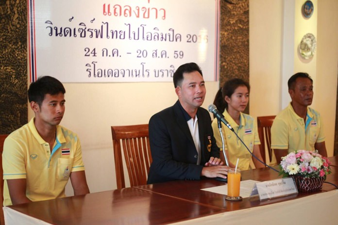 Former Mayor Itthiphol Kunplome (second left) presides over a meeting of the Windsurfing Association of Thailand, held July 15. Windsurfers Nattapong Phonoparat (left) and Siriporn Kaewduang-ngam (second right) will travel to Rio on July 25 to prepare for the Olympic Games.