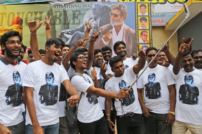 "Fans of Indian superstar Rajinikanth take a selfie outside a cinema hall to celebrate the screening of ""Kabali"" in Chennai, India, Friday, July 22. (AP Photo/Aijaz Rahi)"